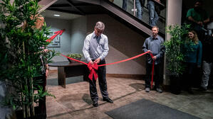 President & CEO John deWolde of SpeedLine Solutions Inc cutting the ribbon at their new Abbotsford office