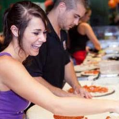 Woodstock's Pizza staff members making pizza