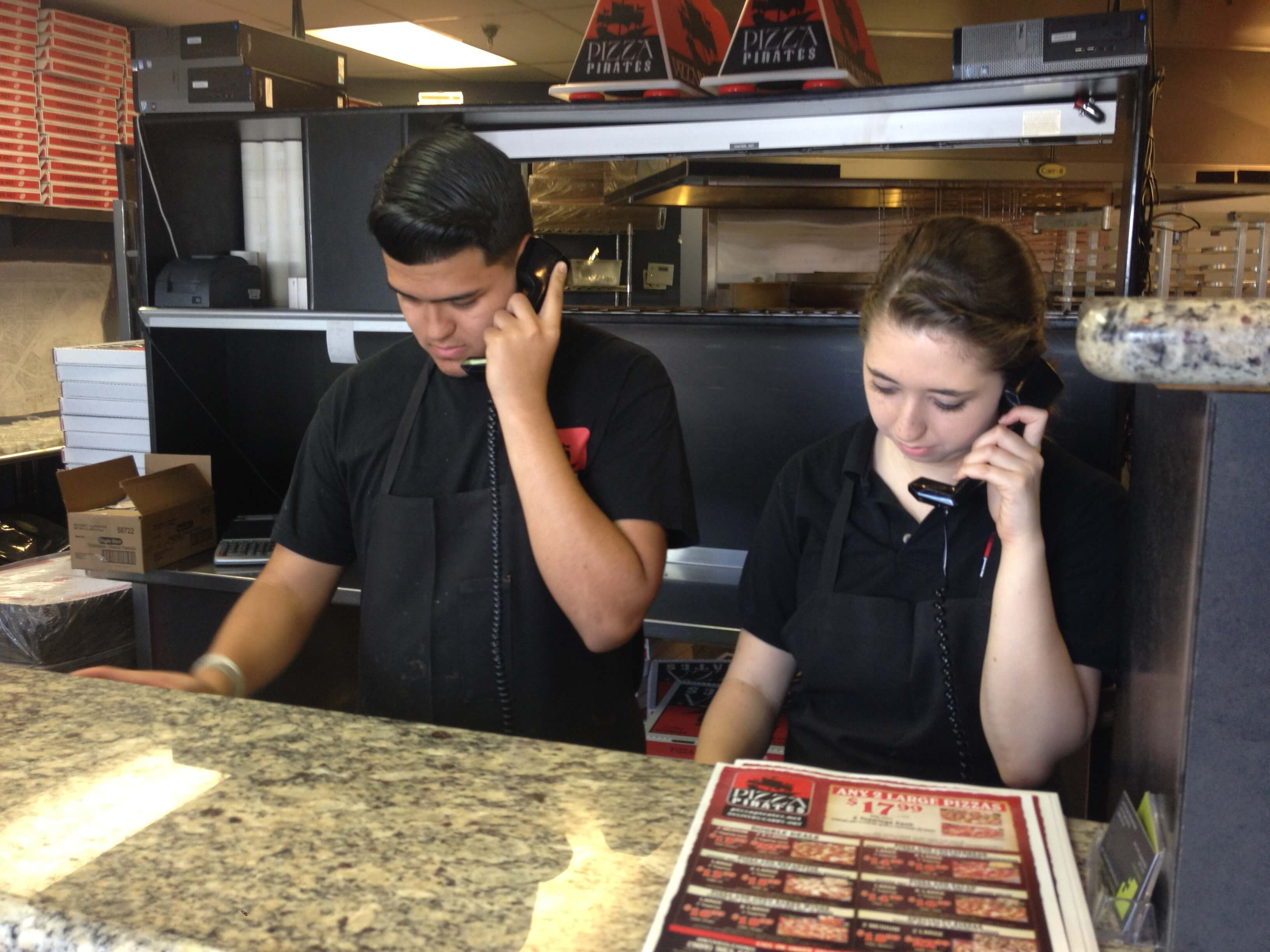 Two Pizza Pirate Employees entering phone orders into the POS